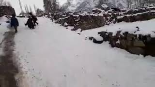 Kids Enjoying Snow By Slipping In Gilgit Baltistan