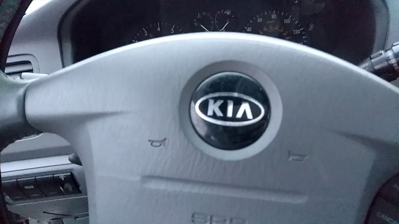 Kia Optima: Closing the hood