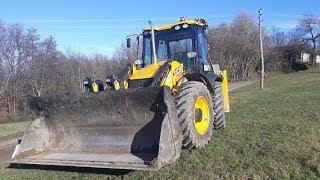 JCB 4cx backhoe loader and Grader repairing gravel roads
