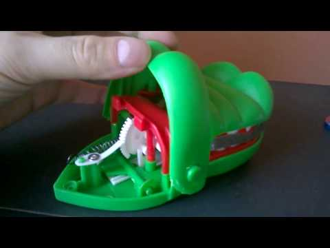 How does the Crocodile Dentist toy work?