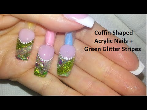 coffin shaped nude french acrylic nails  green glitter