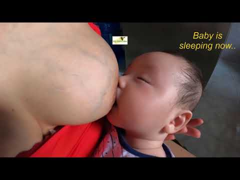 3 months old baby talks to mom Thuy II breastfeeding