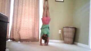 5 year old gymnast kyrie doing press handstands