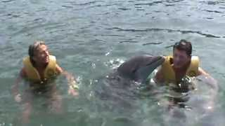 Playing with dolphin in Ocean World