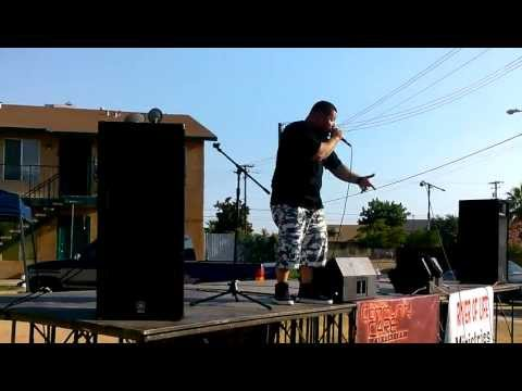 Seven-T rapping at an outreach event in Fresno CA