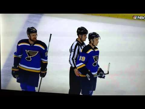Fan hit by hockey puck