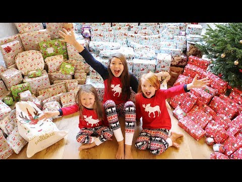 CHRISTMAS MORNING OPENING PRESENTS  MEGA SHOCK REACTION! VLOGMAS DAY 26!
