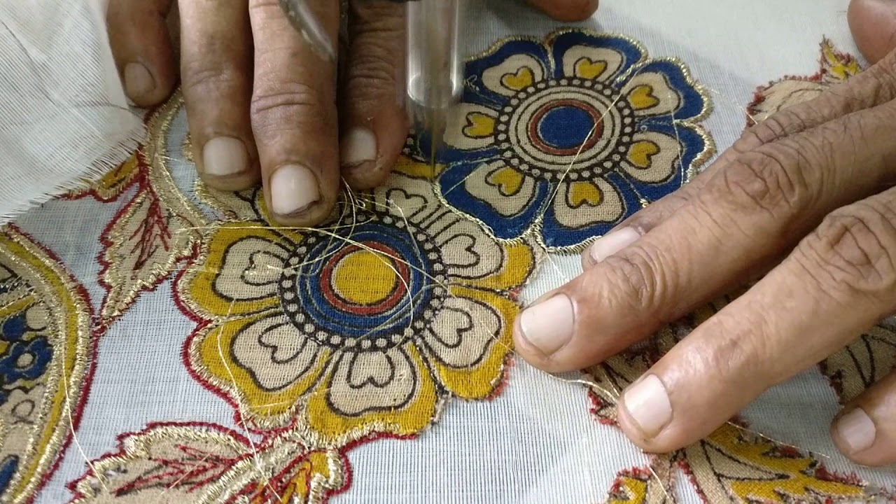 Kalamkari Designs Cut Out From Fabric And Attached To A Kerala Saree
