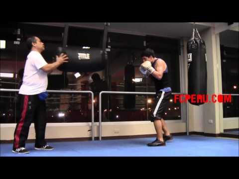 Escuela de Boxeo - Trabajo básico en el saco de hooks y uppercuts