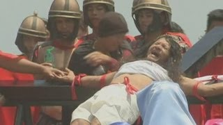 Good Friday crucifixion rituals: Philippine devotees nail hands and feet to wooden crosses