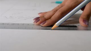 A professional Indian architect working on drawing table in her office
