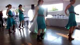 Bride and bridesmaids surprise groom and guests with a wedding dance!