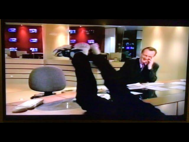 Tim Vine throws himself off a news desk. (Vhs Vine vault.)
