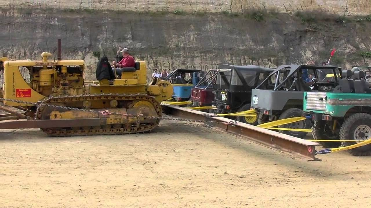 Caterpillar D8 Dozer vs  20 Toyotas Makes for Epic Tug of
