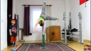 Handstand on pole pomel