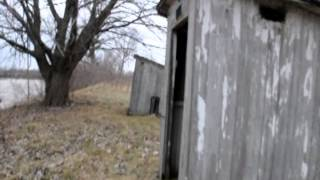 Why Do Outhouses Have Two Holes ?