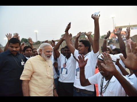 "PM Modi at the launch of environment friendly ""E-Boats"" at Assi Ghat, Varanasi"