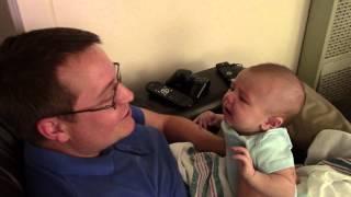 Adorable baby becomes sad when dad
