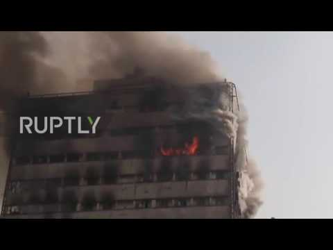 Iran: 30 firefighters feared dead after fire causes Tehran high-rise to collapse