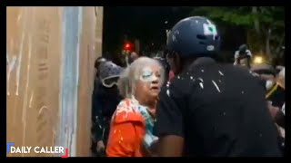 Protesters Dump White Paint On Elderly Woman