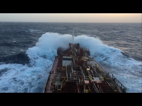 Cargo ship in rough sea and bad weather in Atlantic ocean