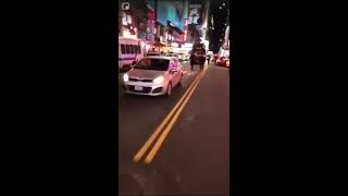 Time square New York hit and run. Run over Cop. Police on the chase. Benz amg