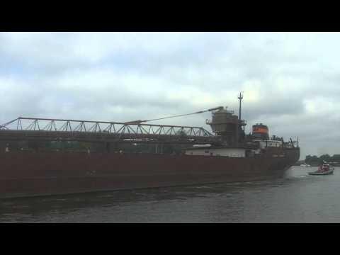 Self Unloader Herbert C Jackson being towed down the Buffalo River