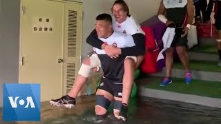 Japanese Rugby Players Brave High Waters to Train During Typhoon