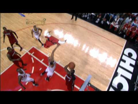 Omer Adik smothers Wade's dunk attempt