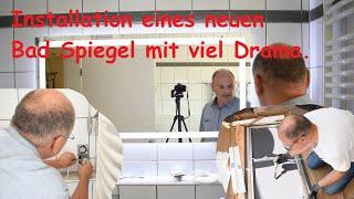 Installation eines neuen Bad Spiegel mit viel Drama.