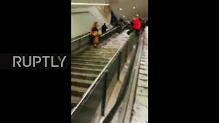 Hailstorm runoff floods underground escalators in Rome
