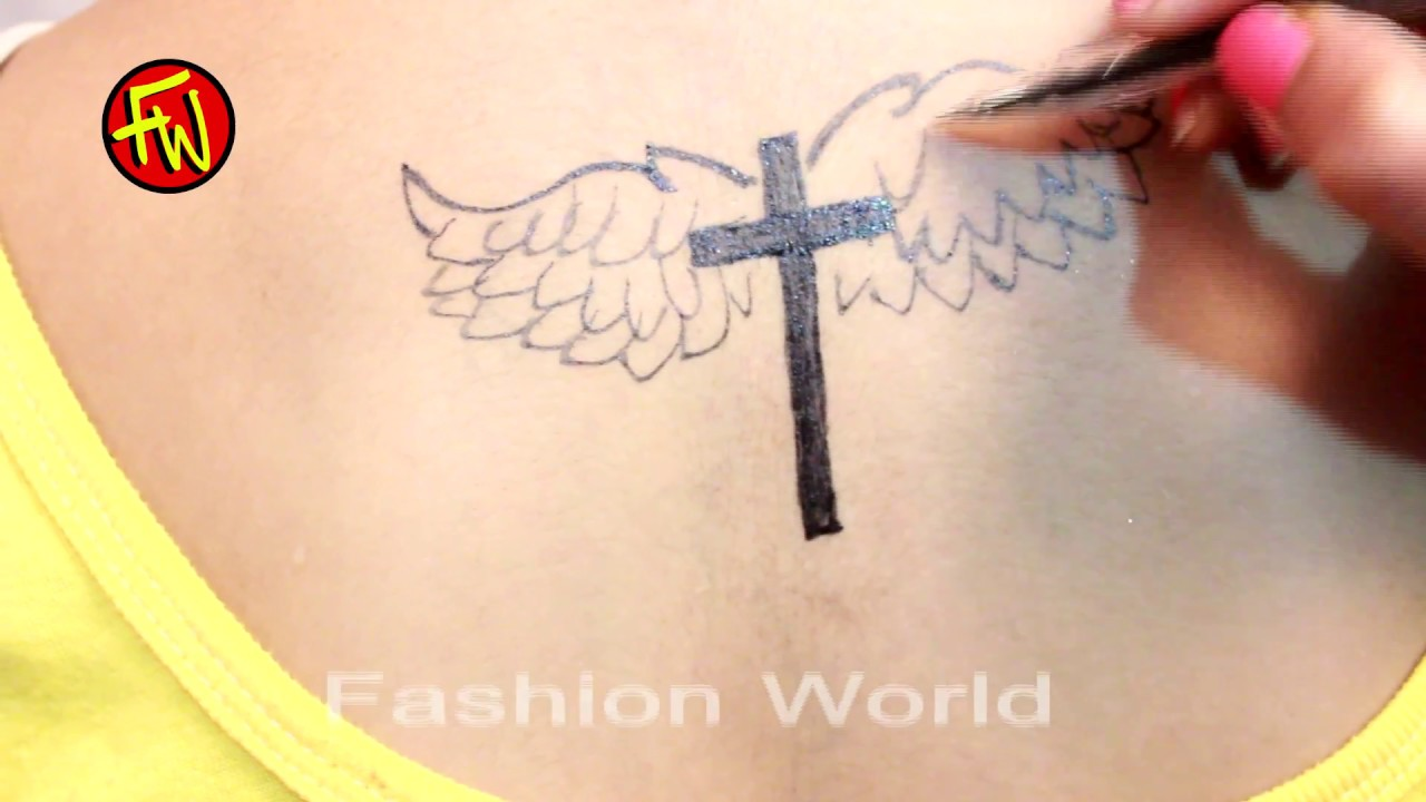 3856513a4 birds wing tattoos - Small Cross Tattoos For Women - YouTube