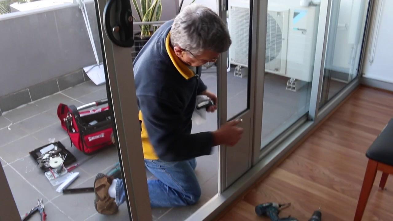 Pet Door Insert Installation In Double Sliding Doors With Wheels At