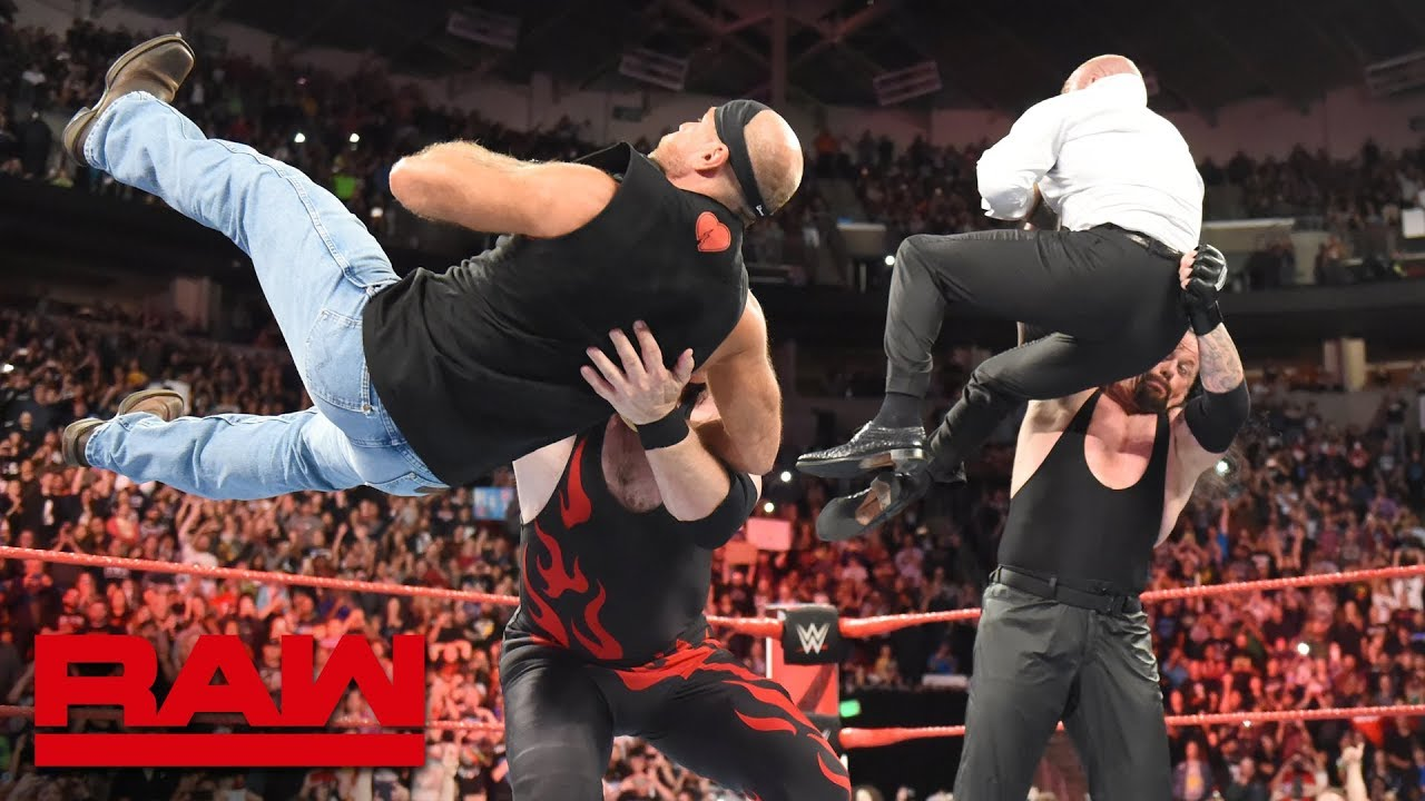 Image result for The Undertaker and Kane take out Triple H and Shawn Michaels on RAW
