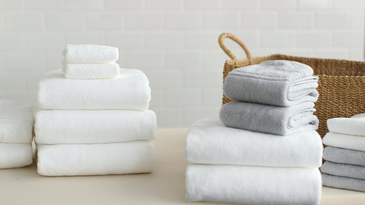 How To Fold Bath Towels- Martha Stewart - YouTube