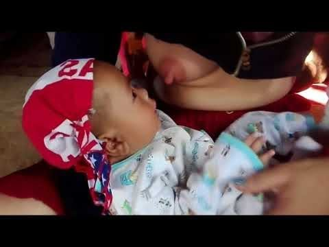 Cambodian Cute Mommy Breastfeeding Cute Baby thumbnail