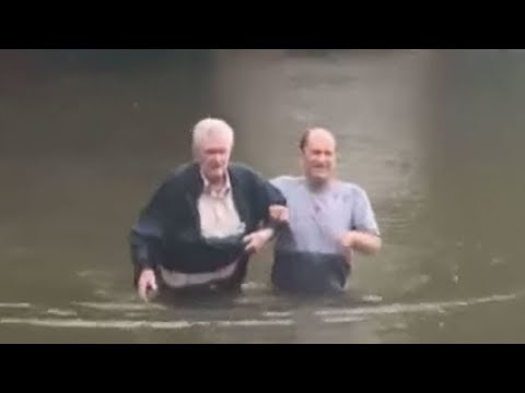 90-Year-Old Couple Wades Through Deep Water After Hurricane Harvey Flooded Home
