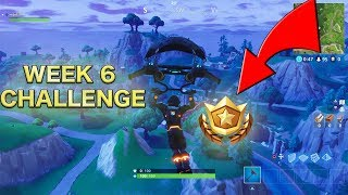 "Fortnite Week 6 Challenge ""Search between a Metal Bridge, Three Billboards, and a Crashed Bus"""