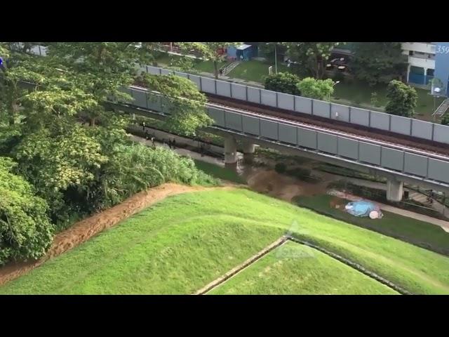 Soil erosion due to heavy rain caused water to gush down slope in Bukit Batok