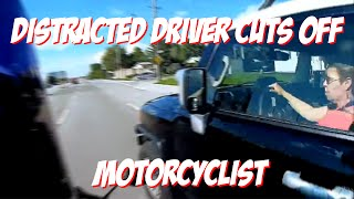 DISTRACTED DRIVER ALMOST KILLED MOTORCYCLIST (MUST SEE)