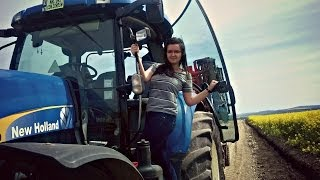 Girl driving a New Holland T7060