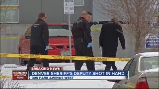 Deputy shot in hand while serving warrant