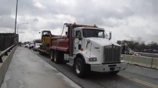 Kenworth Dump Truck Hauling John Deere 75D