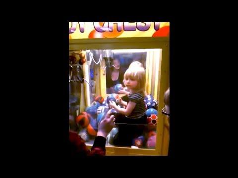 kid gets stuck inside a claw machine..