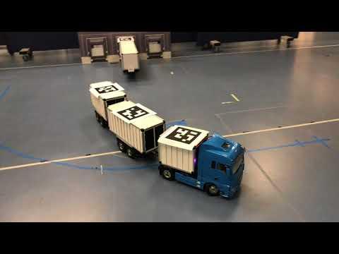 Autonomous Reversing of Double Articulated Vehicles