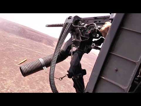 HH-60 Helicopter Door Gunner In Action