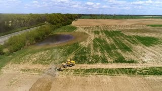 Aerial Footage of a Tractor on a Field. | Stock Footage - Videohive
