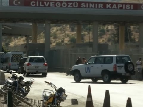 Raw: UN Cars Enter Syria, Aid Stuck At Border