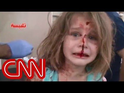 Syrian child cries for father after airstrikes