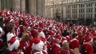 Hundreds of Santas bring festive cheer to London